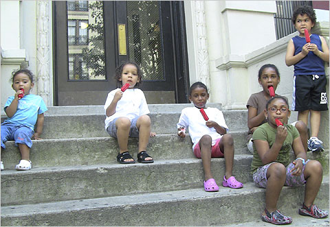 Kids stoop sitting in summertime Baltimore, photo Baltimore Sun.